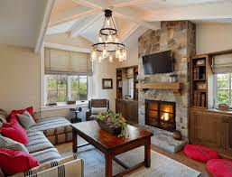 cottage style living room with stone and wood fireplace