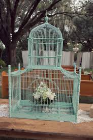 Another vintage birdcage, this one more in your color scheme. (Turquoise bird  cage -- Rent from Ooh!