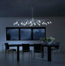 dining table chandelier modern dining room lighting idea with contemporary brushed nickel chandelier over black rectangular