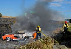 firefighters extinguish an american motors corporation amx from the 1970s along busch drive in fairfield saay sept 29 2018