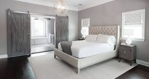 this is another beautiful exle of a contemporary bedroom matched with more rustic sliding barn doors