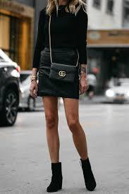 club monaco black sweater top black leather mini skirt outfit gucci marmont handbag stuart weitzman black