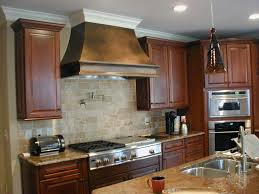 kraftmaid kitchen cabinets ideas using kraftmaid kitchen cabinets with chimney hood with dark brown cherry wall mounted cabinet and brown granite top