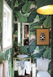 green bathroom screen shot: tropical leaves are the print of summer sources and inspiration on shining on design