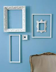 interior decorating in white colors with white vine frames on white walls calls the attention to beautiful designs unique texture and interesting shapes