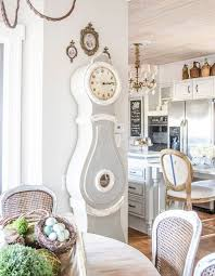 a shabby farmhouse kitchen and dining space with a grandfather s clock in grey and white