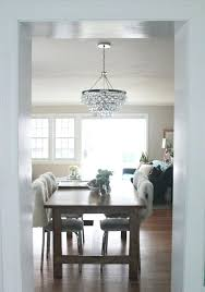 robert abbey bling chandelier minimalist dining room with round clear bulb abbey bling chandelier white fluffy