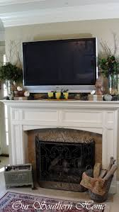 tv on fireplace mantel implausible erikaemeren interiors 12