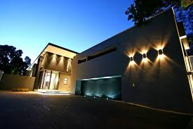 alluring house exterior using contemporary outdoor lighting fixtures on wall above garage and entry doors
