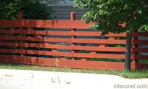 Wood fence with horizontal boards painted red picture interunet