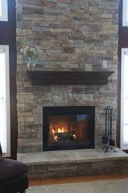 cool stacked gray stone fireplace veneer come with wooden fireplace mantel shelf in espresso finish and