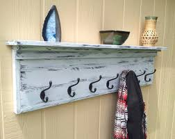 Wooden Wall Mounted Coat Hanger With Top Shelf Having Black Metal Hook With  Wall