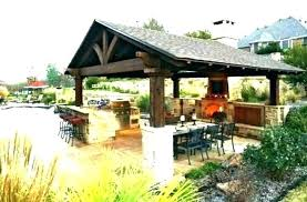 covered patio with fireplace designs and kitchen w
