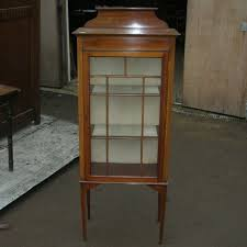 an edwardian single door inlaid display cabinet