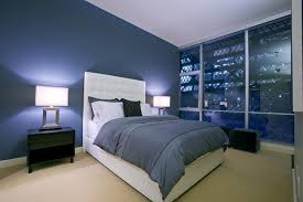 large glass windows for modern bedroom decorating ideas with navy blue wall color using