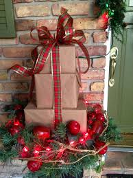 Decorating your front porch with a stack of Christmas packages would be a  nice addition to