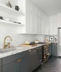 modern cabinet pulls white shaker. Beautiful White And Gray Contemporary Kitchen Boasts Herringbone Floor Tiles Complementing Charcoal Shaker Cabinets Accented With Aged Brass Knobs Modern Cabinet Pulls