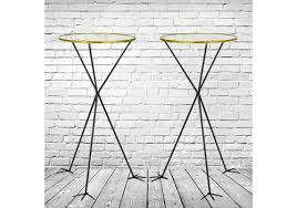 pair of tall glass round topped side tables standing on t