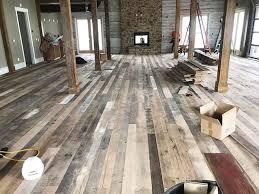 sanding and refinishing reclaimed barnwood floor covering