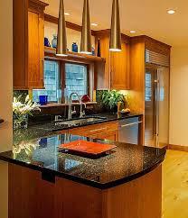 stain grade oak cabinets with black galaxy granite counters