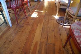 charming dining room applying eco friendly flooring wooden made in brown color completed with various chairs