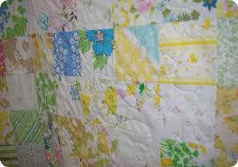 Sew Stormy: Finished Vintage Sheet Quilt & Vintage sheet quilt rolled Vintage Sheet Quilt close-up Adamdwight.com