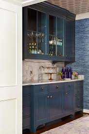 catchy wet bar cabinets with sink blue wet bar boasts blue glass front cabinet suspended over