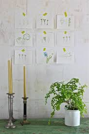 above our final prints arranged on the dining room wall make a charming and extemporaneous homage to spring