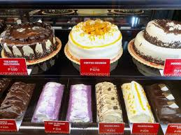 It is a vanilla sponge cake lightly soaked with coffee syrup, layered with smooth whipped cream and coffee cream, and covered with delightfully crunchy coffee candy. Red Ribbon San Joaquin Pasig Booky