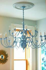 spray painted brass chandelier