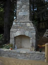 this outdoor fireplace in boone nc makes this deck feel more like an outdoor living room