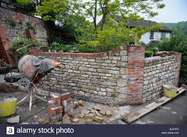 garden pillars. Building A Garden Wall With Cotswold Stone And Cement Mortar Reclaimed Red Brick Pillars Coping UK