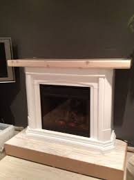 how to transform a bought electric fireplace into a striking piece unique to your