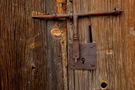 outdoors photograph a rusty barn door lock on an old by medford taylor