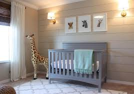 boy s nursery with beige shiplap accent wall