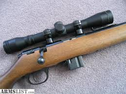 simmons 4x32. marlin model 25mn .22 magnum with simmons 4x32 scope, and 3 ea. 7 round magazines. less than 50 have been fired in the rifle, it is excellent 4x32 m
