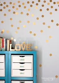 gold polka dot wall from contact paper