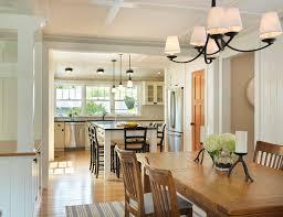 over the table lighting. farmhouse medium tone wood floor kitchendining room combo idea in providence over the table lighting