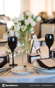table number 1 on black wooden stand glasses and cutlery