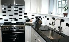 black backsplash black black subway tile backsplash with white cabinets
