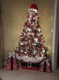 Using a Rubbermaid container to sit your Christmas tree in. So cute! I love  this Santa tree idea.