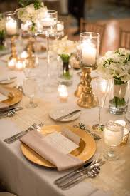 charger plates decorative: http wwwelizabethannedesignscomblog http wwwelizabethannedesignscombloggold ivory ballroom weddinggold chargers reception decor