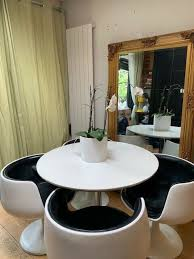 retro vintage white round dining table and 4 bucket chairs