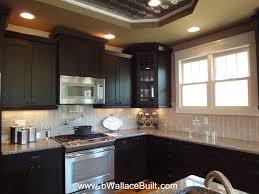 Dark Cabinets Light Granite Countertops And Grey Vertical Subway Kitchen  Backsplash For