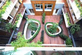green eco office building interiors natural light. trees grow through two u201ceyesu201d of a suspended garden at this renovated building in milan green eco office interiors natural light