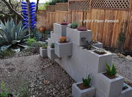 make a cinderblock wall planter digging cinder block garden wall