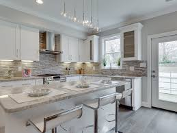 white kitchen pendant lighting. Exquisite Transitional Kitchen White Cabinets Features Pendant Lighting And With Counter Stools