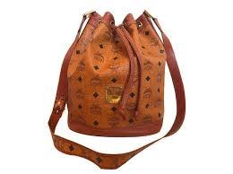 mcm drawstring cross bag in visetos cognac print handbags leather other brown black