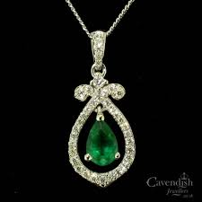 ornate 18ct white gold emerald and diamond pendant