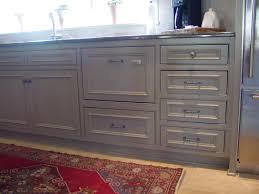 kitchen base cabinet with custom dishwasher drawer panels
